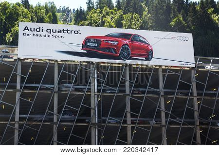 SCHLADMING, AUSTRIA - AUGUST 15: Audi quattro car poster on parking house on August 15, 2017 in Schladming, Austria. Audi Starts Training Its Employees On Big Data And A.I.