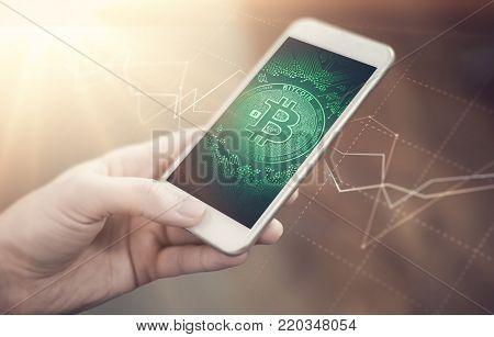 Bitcoin symbol on mobile app screen. Bitcoin wallet app. New digital money.