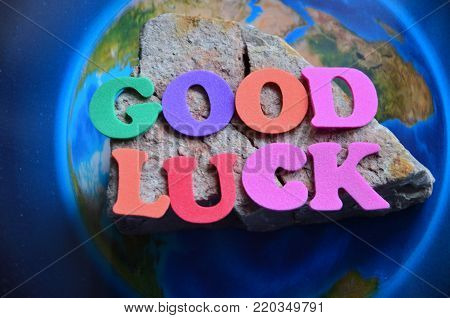 word good luck on an abstract  colored background