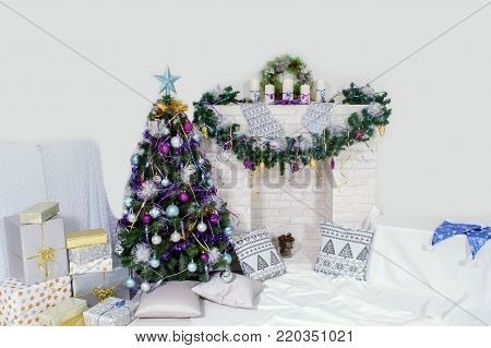 Christmas decoration of the premises. The design is festive with candles and fir branches.