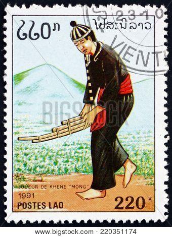 LAOS - CIRCA 1991: a stamp printed in Laos shows man playing mong, musical instrument, circa 1991