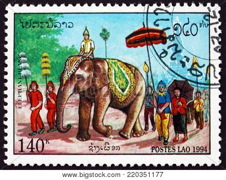 LAOS - CIRCA 1994: a stamp printed in Laos shows elephant in the procession, circa 1994