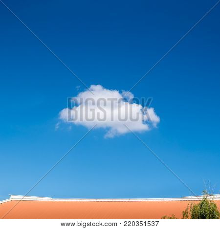 Single Tiny Cloud On Blue Sky. Single Fluffy White Cloud In Bright Summer Blue Sky.