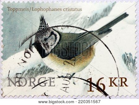 LUGA, RUSSIA - MAY 14, 2017: A stamp printed by NORWAY shows the European crested tit, or simply crested tit - a passerine bird in the tit family Paridae, circa 2015
