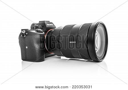 UZHGOROD, UKRAINE - JANUARY 01, 2018: Sony Alpha a7 III Mirrorless Digital Camera Body and lens with 42MP Full-Frame Exmor R BSI CMOS Sensor on white background.
