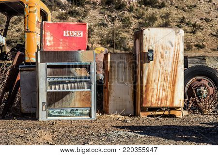 Vintage Vending Machine & Rusted Refrigerator In Junk Yard