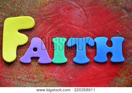 word faith on an abstract colored background