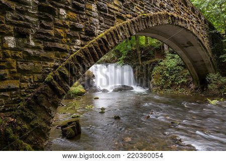 Under the waterfall in Whatcom Falls Park in Bellingham Washington State