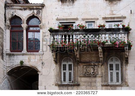 SPLIT, CROATIA, MAY 11, 2010: Decorative stone balcony in historic part of Split, Croatia. Balkan architecture