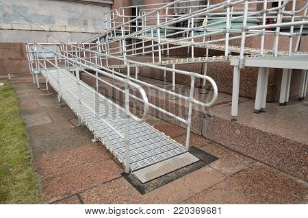 Ramp for wheel chair.With his help overcome the up stairs.