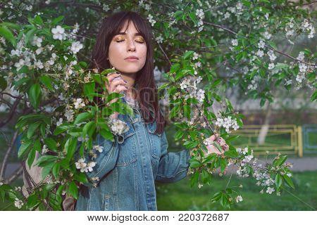 Woman applying perfume on her body outdoors