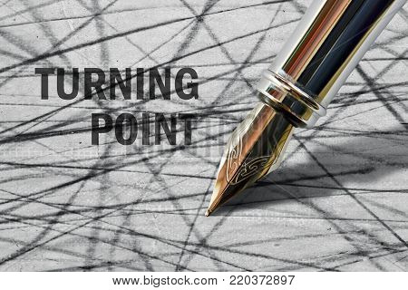 Closeup of the nib of a fountain pen and text Turning Point