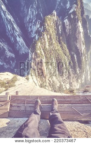 Plank Road in the Sky at Mount Hua, worlds most dangerous hike, color toned picture, China.