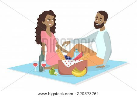 Couple at picnic. African couple sitting on blanket with food on white.