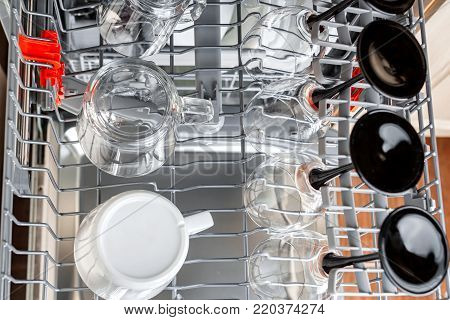 Clean glasses and cups in the basket after washing in the dishwasher. Top view