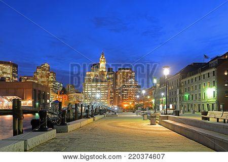 Boston Custom House, Long Wharf and Financial District skyline at night, Boston, Massachusetts, USA.