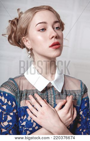 Fashion Beauty Portrait. Beautiful Blonde Girl, Model Woman Wearing Long Evening Prom Chiffon Dress.