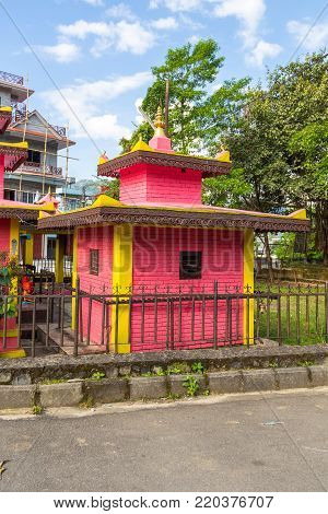 POKHARA, NEPAL - September 29, 2013: Small hindu temple in Pokhara town. Pokhara is the starting point for most of the treks in the Annapurna area.