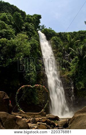 Natural background waterfall full of story legends waterfall Indonesia, Songgo Langit  Waterfall Jepara.