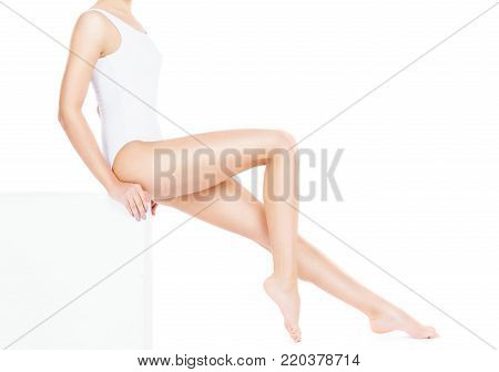 Close-up of beautiful, fit and sporty woman in underwear isolated on white. Health, sport, fitness, depilation, cellulite and hair removal, healthcare, healthy life-style concept.