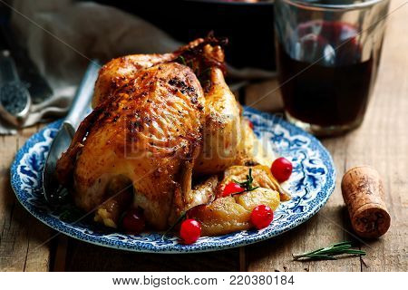 cranberry apple stuffed cornish hens.style rustic.selective focus