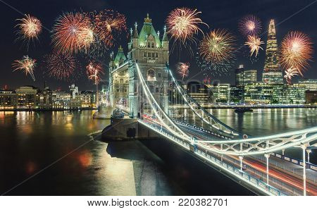 View of the Tower Bridge in London at new years eve with amazing fireworks. ideal for websites and magazines layouts