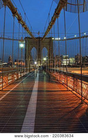 Brooklyn Bridge pedestrian and cycling path at evening.