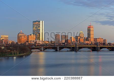 Boston Back Bay Skyline John Hancock Tower and Prudential Center at twilight, viewed from Cambridge, Boston, Massachusetts, USA.