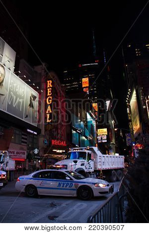 Manhattan, New York, December 31, 2017: Nypd Car And Truck On Theater District Next To Times Square