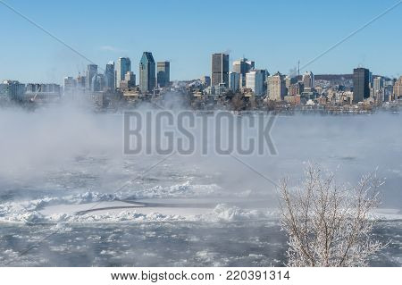 Montreal, CA - 1 January 2018: Montreal Skyline in winter as ice fog rises off the St. Lawrence River