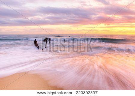 Sunrise at the Dick Beach shipwreck at Dicky Beach (Caloundra) on the Sunshine Coast in Queensland, Australia