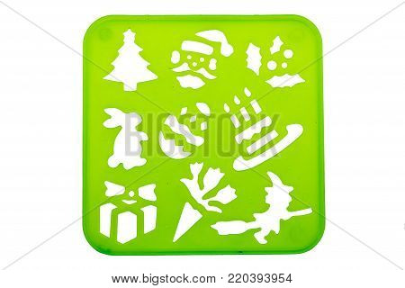 Holiday stencil shapes on a green background