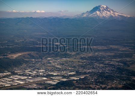 Mt Rainier in the backdrop of Seattle - City and Mountain with space for text - Nature and Industry