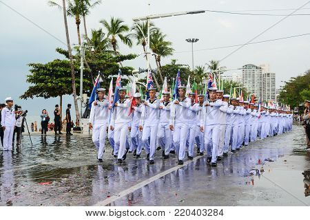 Pattaya, Thailand - November 19, 2017: Thai marines with multi-national flags parade marching on the 50th anniversary ASEAN International Fleet Review 2017 at the beach of Pattaya, Thailand