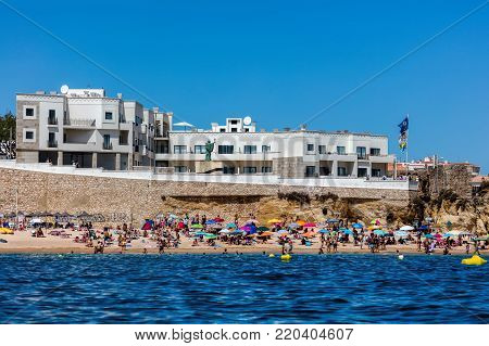Lagos, Portugal, August 18, 2017: Praia da Batata beach is the closest to the center of Lagos, Portugal and tends to get very crowded on the weekends during the summer months.
