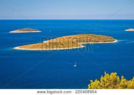 Islands in blue sea aerial view near Primosten archipelago, Dalmatia, Croatia