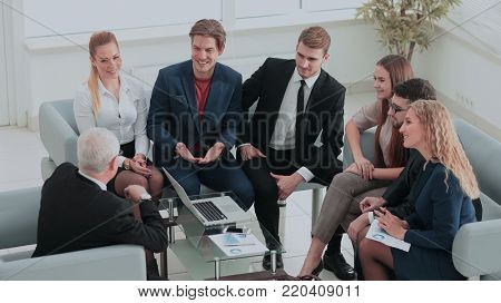 Group of business people brainstorming together in the meeting r
