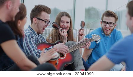 Happy young people having fun and playing different musical inst
