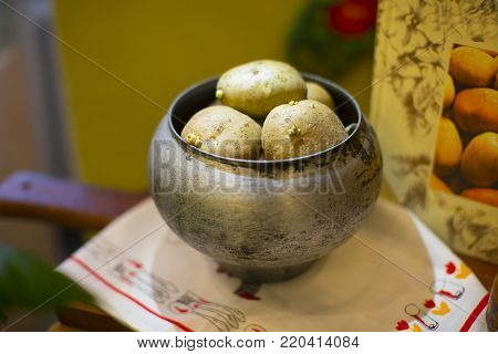 Boiled potatoes in an old iron cast iron