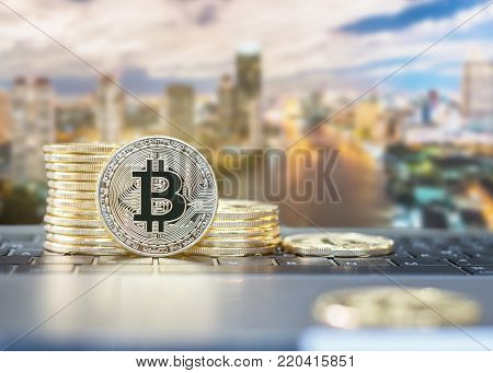 Bitcoin cryptocurrency declining gold stack coins of virtual digital currency for fintech financial banking business and world stock exchange investment via internet online computer technology concept