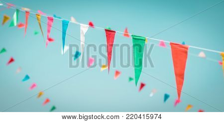 Fair flag blur bunting background hanging on blue sky for fun festa party event, summer holiday farm feast celebration, carnival festival event, park or street design decoration element poster