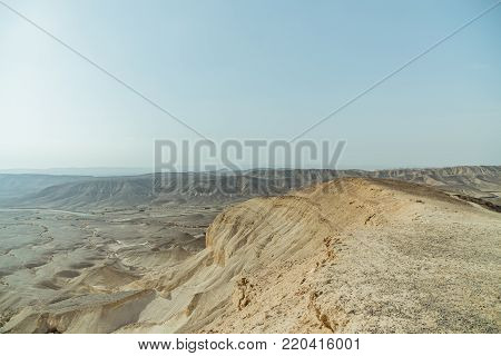 Landscape horizon view on dry desert near the dead sea in Israel. Infinity valley panorama of lone sand, rocks, hills and stones. Waterless middle east territory, silence and heat.