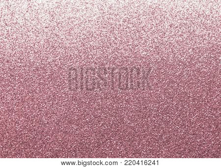 Rose gold pink glitter texture background shiny metallic wrapping paper in purple color with reflective metal surface for Valentine's day holiday decoration wallpaper backdrop design element