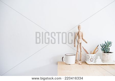 Eclectic home decor, house plants and vases on tray on white wall background