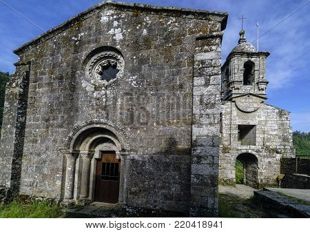 Facade and stone belfry of the ancient Monastery of Caaveiro, dating from the 10th century and which was home to hermits of the area, in Galicia, Spain.