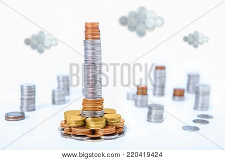 skyscraper of money in capital city of coins financial concept