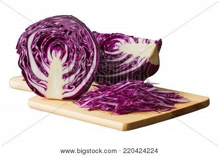 Chopped or sliced fresh purple cabbage on cutting board to shredded on white isolated background with clipping paths. Prepare vegetable for cooking cabbage salad or coleslaw. Homemade food concept of fresh purple cabbage. Red cabbage with clipping paths.