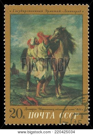 USSR - circa 1972: Stamp printed by USSR, Color edition on art, shows painting Moroccan Saddling a Horse by Eugene Delacroix, circa 1972