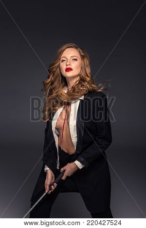 sexy woman with unbuttoned shirt standing with golf club