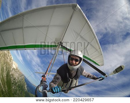 Brave hangglider pilot selfie shot taken with wide angle action camera poster